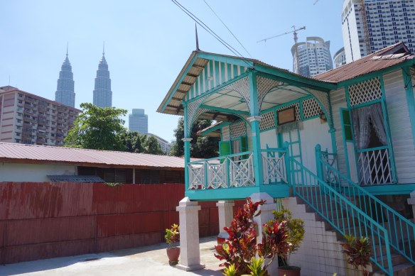 Kampung Baru with its low-rise homes is also near the Chow Kit Market and contrasts with the modern twin towers in the background.